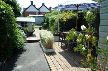 Rear garden with decking and patio area_Island Cottage