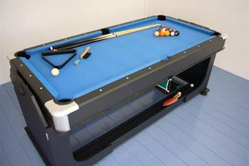 Games room with reversible pool / table tennis table