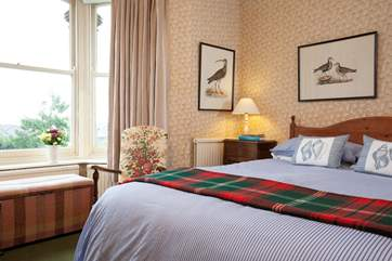 The comfortable double bedroom is spacious and light.