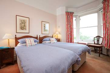 The large twin room offers lovely views out to the sea.