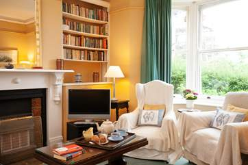 A comfy sitting room is the perfect place for lounging after a day on the beach.
