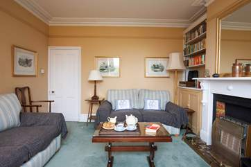 The sitting room boasts plenty of seating for the whole family.