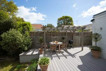 The decking is a delightful space to light up the barbecue in on a summers evening