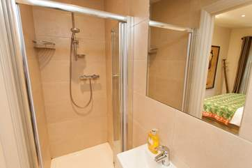 The en suite off the master bedroom has a shower to wash away the sand from inbetween your toes
