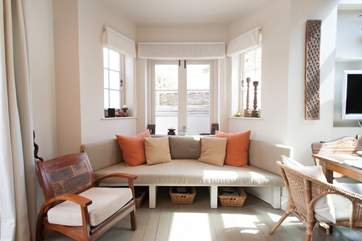 As well as the modern and comfy window seat, there is an additional sofa in the living room for ultimate comfort