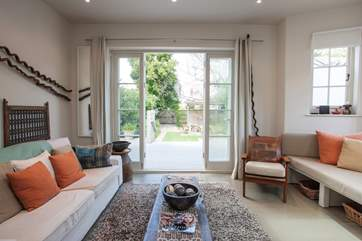 On a warm day, open up the patio doors from the lounge out to the lovely garden