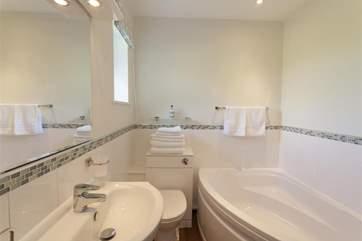 Ensuite bathroom with corner bath