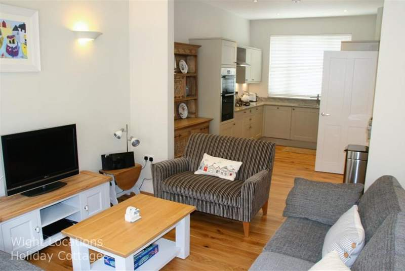 Living area with large seating area, through to well equipped Kitchen