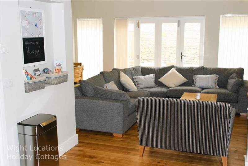 Ample seating in open plan living area with patio doors onto Garden