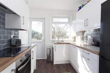 Modern Kitchen with door to garden and decking area
