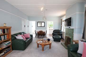 The bright sitting room has plenty of comfy seating.