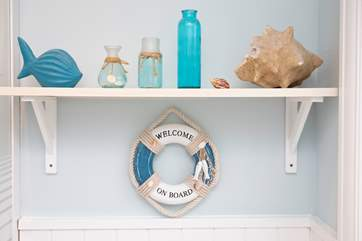 The seaside decor is charming and fresh.