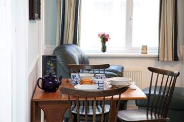 There's a tidy table and chairs outside the kitchen where you can enjoy breakfast and evening meals.
