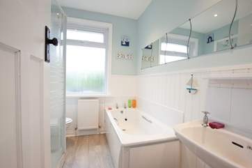 The family bathroom offers both a bathtub and shower.