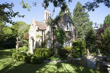 The house is surrounded on all sides by a secluded and well maintained mature garden.