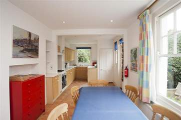 The large open plan kitchend and dining area has a door out to the rear enclosed garden