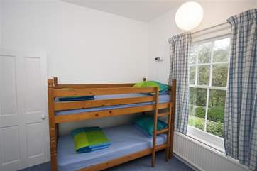 The childrens bunk room overlooks the garden