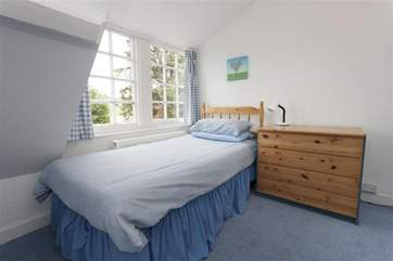 The single bedroom is in the eaves, the perfect hideaway for teenagers