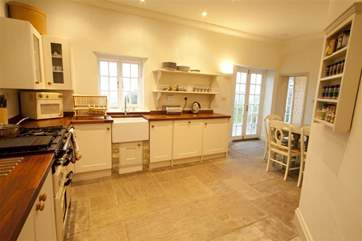 Traditional kitchen with doors onto Garden