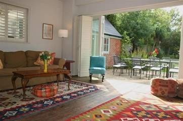 Lounge with bi-fold door onto patio