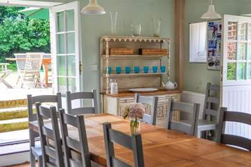 Dining area in Kitchen with doors to garden