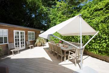 The parasol over the outside table is brilliant for eating in the shade and enjoying your chilled drink.