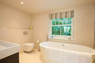 The elegant en suite off the master bedroom is a little piece of heaven when it comes to the ultimate relaxation.