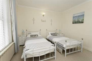 The twin bedroom is light and airy
