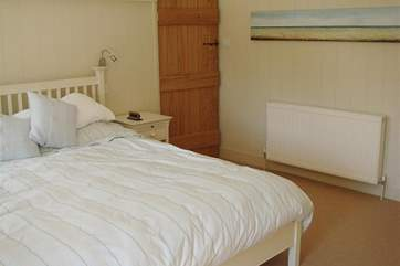 Master bedroom with super king size bed and en-suite toilet