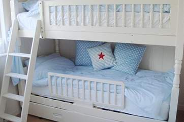 Bunk bedroom with nautical seaside feel for the younger guests