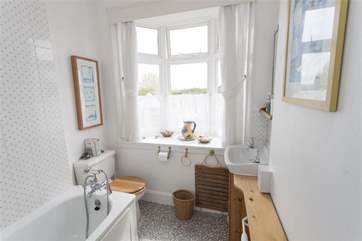 Family bathroom with shower over the bath