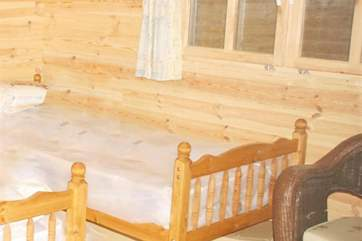The twin beds in the chalet offer flexibility for sleeping in the warmer months between 30th April and 30th September.