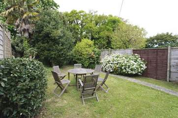 Fully enclosed garden with outside dining furniture
