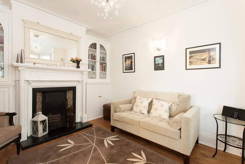 At the front of the house is a bright, inviting living room, an ideal space for quiet time.