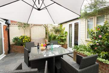 For some time in the sun, take a seat outside in the patio area, completly enclosed perfect for children and for pets