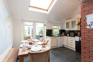 Open up the patio doors into the garden whilst cooking up a favourite meal in the kitchen, and enjoy in the sunshine