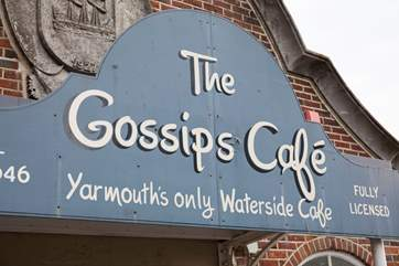 Watch the ferries sail into port from Gossips Cafe, Yarmouths only waterside cafe with fabulous tea and cake