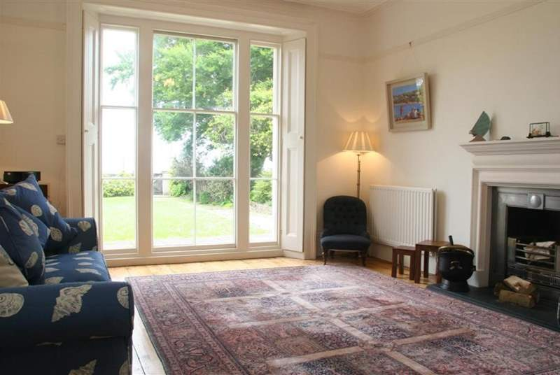 Lovely high ceilinged living room with french doors to the garden