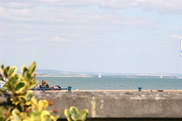 Enjoy watching the yachts sail past from the end of the garden