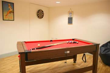 Once tired of the snug and the books, why not play a game of pool