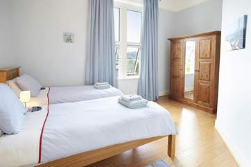 Light and airy twin bedroom with views to the rear