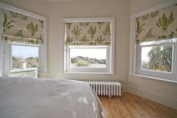 Enjoy the views from the main bedroom across the gardens and out to the sea