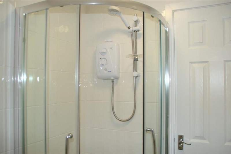 Family bathroom with corner walk-in shower