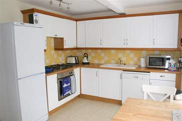 There is a fully-equipped kitchen with a breakfast dining-area.