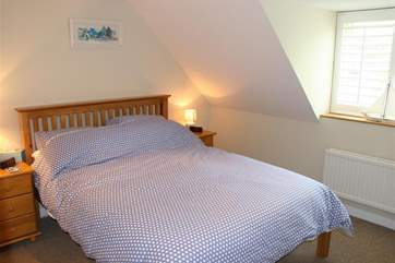 Get comfy under the eaves in the main bedroom.