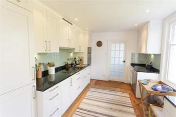 Lovely modern kitchen with attached utility-room