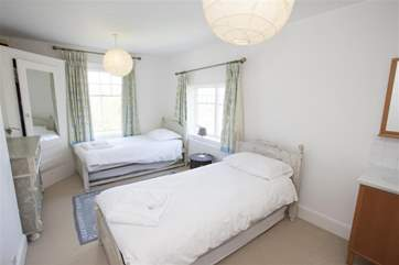 Twin bedroom on first floor with pull out trundle beds (there is minimal room between beds with all four set up - great fun for children but adults should be aware!)