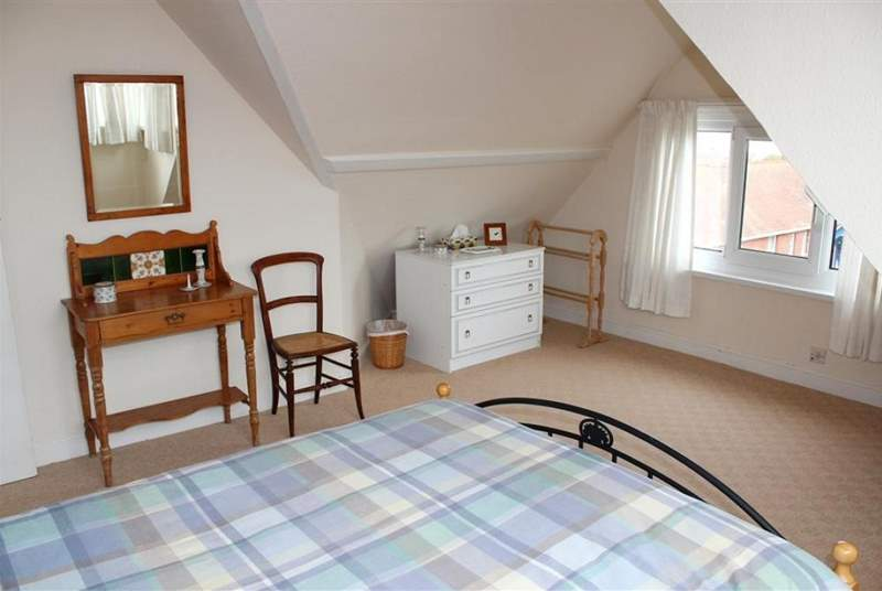 The Master bedroom has views of the Solent over the rooftops of Seaview village