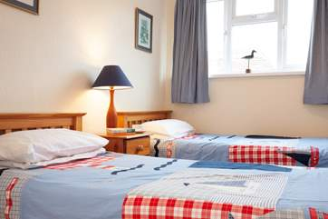 A bright and cheerful twin room.