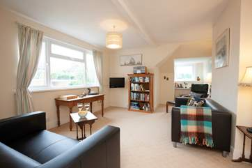 Plenty of space in the sitting room for relaxing or planning your daily outings.